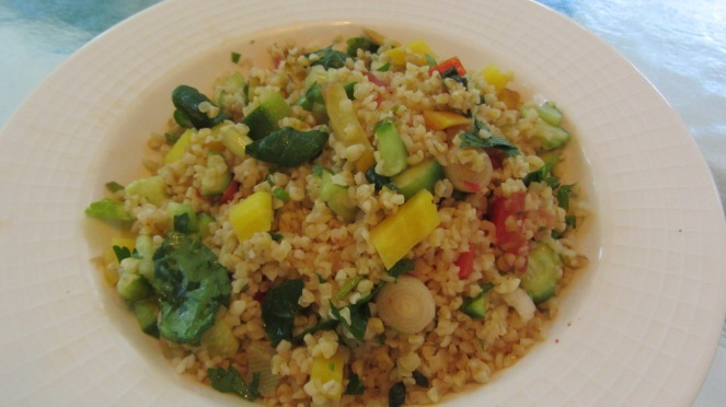 Tabouli salad with organic vegetables and herbs