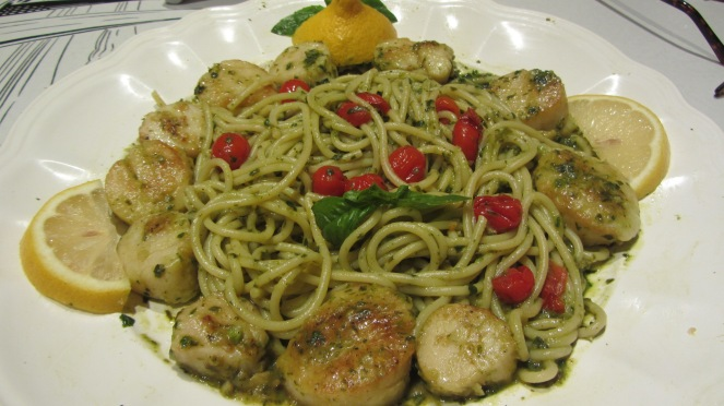 Sauteed local scallops with light lemon wine basil sauce with cherry red tomatoes