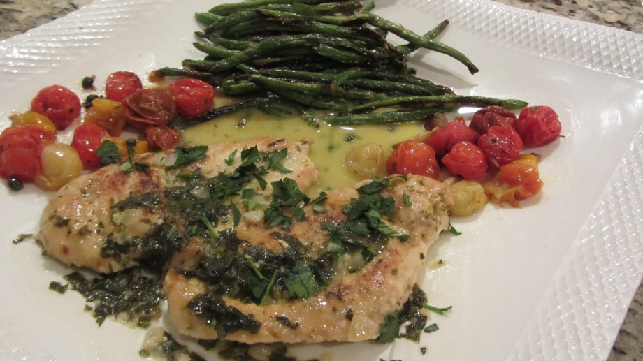 Chicken cutlet francaise with lemon, wine sauce, roasted cherry tomatoes and green beans